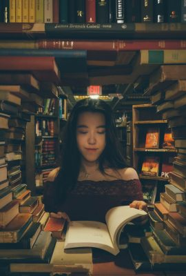 lady-reading-a-book-in-a-library-2793466